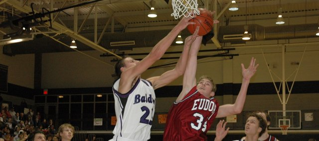 Eudora junior Drew Noble battles for the ball Friday night at Baldwin. The Eudora boys trailed at the half but came back and beat the Bulldogs 47-45 in overtime.
