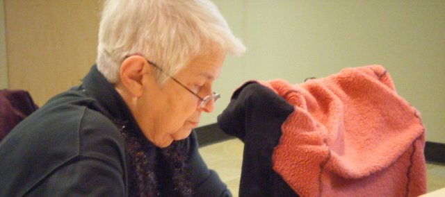 RoJean Mustain works on one of her writing prompts at the Basehor Community Library writer's group. The group had its monthly meeting on Saturday and serves as a way for Basehor writers to get informal writing time.