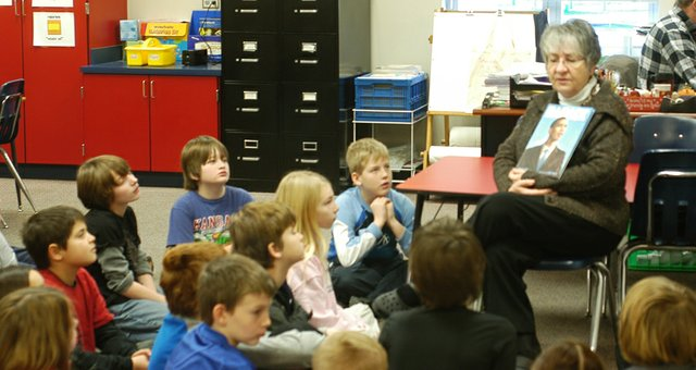 "Paula Henderson discusses ""Barack"", an illustrated children's book with fourth graders at Starside Elementary, Tuesday."