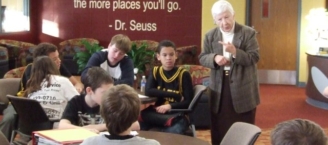 Sister Rosemary Flanigan, a member of the Sisters of St. Joseph of Carondelet, speaks with Clark Middle School students Thursday about her involvement in the civil rights movement. Flanigan marched with fellow nuns in Selma, Ala.