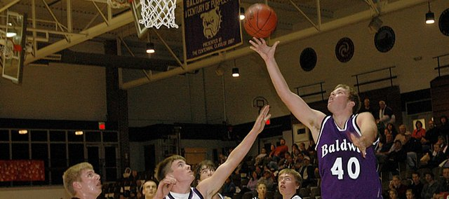 Baldwin High School junior Zach Wright (No. 40) attempts a layup during the Bulldogs' scrimmage in December. Wright transferred from Wellsville and he will be playing his first game for BHS Friday at Paola.