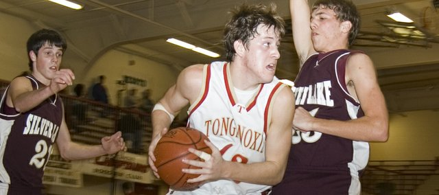 Austin Smith maneuvers along the baseline in the second half on Tonganoxie High's 57-49, opening-round defeat of Silver Lake on Tuesday at the Tonganoxie Invitational. Smith scored a game-high 23 points.
