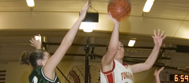 Chrissie Jeannin scores the final bucket of Tonganoxie High's 28-0 run against De Soto in the first round of the Tonganoxie Invitational on Tuesday. Jeannin scored 10 points in the 53-27 THS victory.