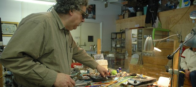 Moon Marble owner Bruce Breslow gets his workstation ready for another marble-creating demonstration. His store is a finalist in the 8 Wonders of Kansas Commerce contest, and though sales are down right now, he is keeping his focus on business as usual.