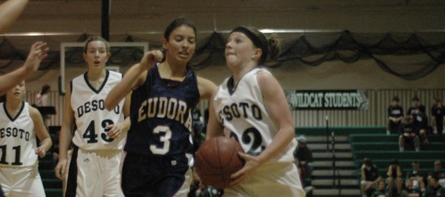 Shelbi Petty drives to the basket against Eudora Friday at De Soto. The Wildcats stayed with the Cardinals for most of the game before falling late, 60-36. The Wildcats lost to Tonganoxie 53-27 in the opening round of the Tonganoxie Invitational Tuesday night. De Soto will play Jeff West at 6 p.m. Thursday.