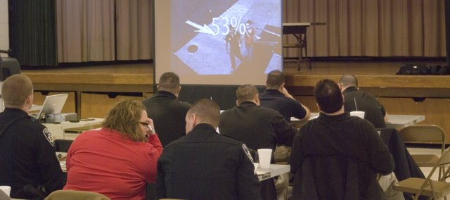"Police Officers attend training Wednesday for a new alert program called  ""A Child is Missing."""
