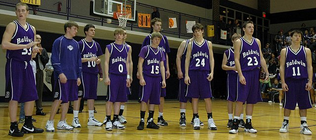 Baldwin High School's boys' basketball team awaits its second-place trophy Saturday night. The Bulldogs were beaten 50-48 by Kansas City Christian in the Baldwin Invitational Tournament championship.