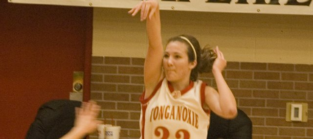 Chrissie Jeannin follow through on a three-point attempt Saturday afternoon during Tonganoxie's 54-39 victory in the third-place game of the Tonganoxie Invitational.
