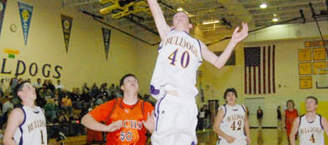 Gavin Swearngin goes up for a lay-in against Atchison County on Friday night at McLouth High. A freshman, Swearngin has been playing better of late and helped the Bulldogs pick up their first victory of the season this past week at the McLouth Tournament. MHS finished fourth at the tourney.