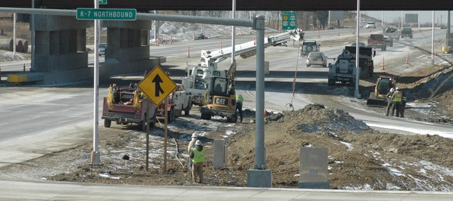 Crews finish some utility work at the newly reopened interchange at Kansas Highway 7 and U.S. Highway 24-40. The interchange reopened Friday after being closed in March 2008.