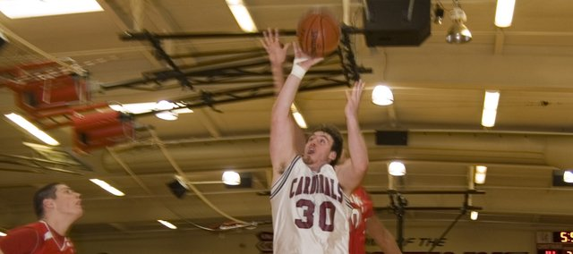 Cody Carlson goes up for a shot against Lansing in the third-place game of the Tonganoxie Invitational. The Cardinals lost the game, 63-43, and finished the tournament in fourth-place. 