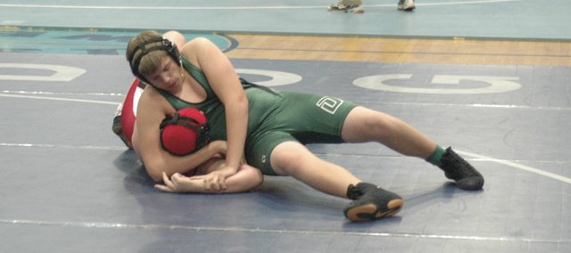 De Soto freshman T.J. Higdon wrestles at 189-pounds earlier in the season. The Wildcats beat Wellsville and lost to Osawatomie last Thursday.