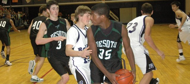 De Soto sophomore Jeff Bowen looks for an open teammate against Baldwin. The Wildcats hit 10 threes in their 57-45 road win last Friday night.