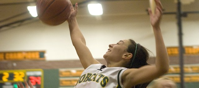 Basehor-Linwood sophomore Courtney Poe hauls down a rebound during the Bobcats' victory over Tonganoxie. Poe scored a team-high 12 points.