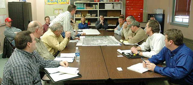 David Contag, standing center, talks with Baldwin City officials about the Baldwin School District's bond issue projects Friday afternoon. Contag is an architect with DLR Group. City streets and annexation of district property were the primary topics at the meeting.