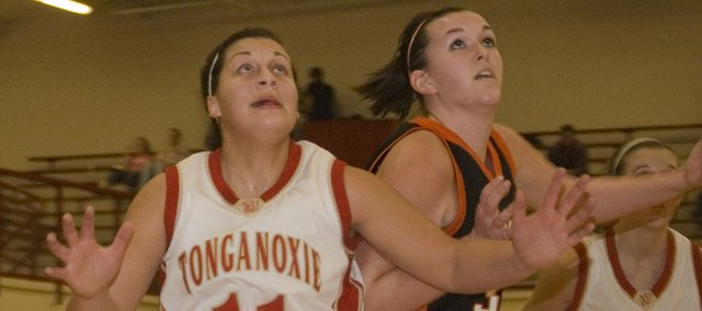Roni Grizzle boxes out one of her Bonner Springs opponents during Tonganoxie High's 55-39 victory on Tuesday. Grizzle scored 19 points and grabbes six rebounds.