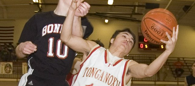Rob Schlicht tries to hang on to a rebound against Bonner Springs on Tuesday. The Tonganoxie High senior guard was one of 10 Chieftains to score against the Braves in an 83-62 THS victory.