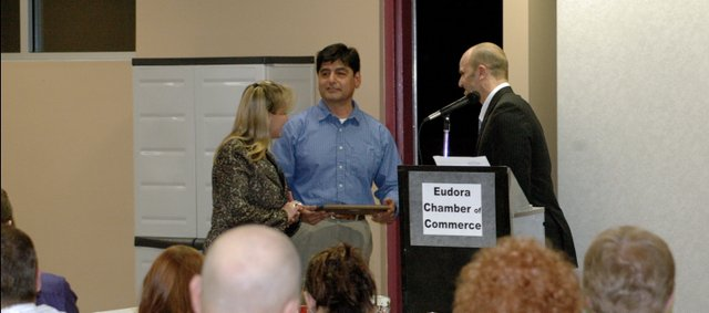 DeeAnn and David Alvarez, owners of Coffee Talk, accept the 2008 Chamber of Commerce Business of the year from chamber president Doug Mateo. 