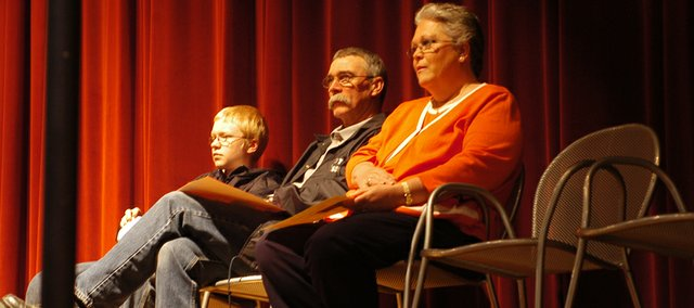 Dylan Ritter, Mike Frehe and Dottie Burns await the beginning of the LTMS Kindness Assembly on Tuesday.
