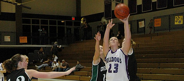 Baldwin High School senior Alex Zordel (No. 23) scores two of her game-high 18 points Tuesday as the Bulldogs beat De Soto 52-33. It marked the first Frontier League victory for the Bulldogs this season.