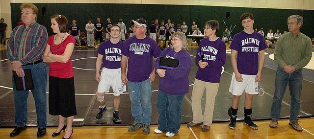 Baldwin High School's wrestling program celebrated senior night last week. Three of the seniors honored were manager Sarah Johnson, Alan Callahan and Colin Busby. Each are shown with their parents.