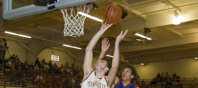 Keaton Schaffer goes in for a layup during Tonganoxie High's 58-44 victory against Santa Fe Trail on Friday. Schaffer led THS with 23 points.