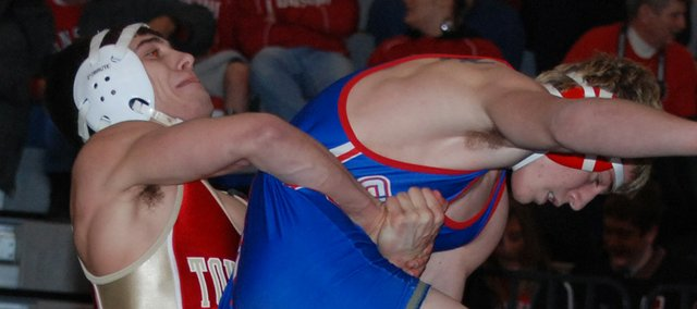 Matt Brock takes down Ryan Weaver in the Kaw Valley League 140-pound championship match on Saturday at Bonner Springs. A Tonganoxie High senior, Brock won the match, 3-1, for his first KVL title.