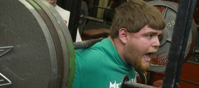 Eric Lucas hollers while working on his squat at Tonganoxie High power lifting practice recently. After a lengthy hiatus, the power lifting team has been revived this year and has already found success as the boys finished second and the girls took first on Feb. 7 at Horton.