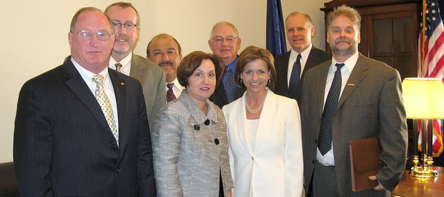 A group of representatives from Leavenworth County met with Congresswoman Lynn Jenkins in her office Friday morning in Washington D.C. Pictured from the left are: Scott Miller, Leavenworth city manager; Steve Jack, director of the Leavenworth County Development Corporation; Mike Yanez, Tonganoxie city administrator, Lisa Weakley, Leavenworth mayor; Tom Putthoff, Tonganoxie city council; Jenkins, R-Topeka; Chris Donnelly, executive vice president at MidAmerican Bank and Trust; Ken Miller, Lansing project liaison and public information officer.