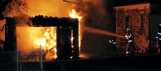 Members of the Eudora Fire Department fight a garage fire in January. There were 156 fire calls in 2008, up 21 from the 135 calls in 2007.