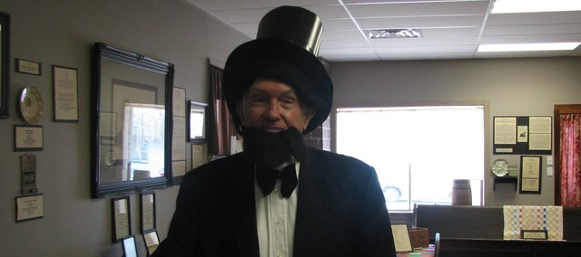 Chuck Wilderson poses as Abraham Lincoln Feb. 12 at the Basehor Historical Museum. Author Carol Ayres and community members gathered at the museum to celebrate Lincoln's 200th birthday.