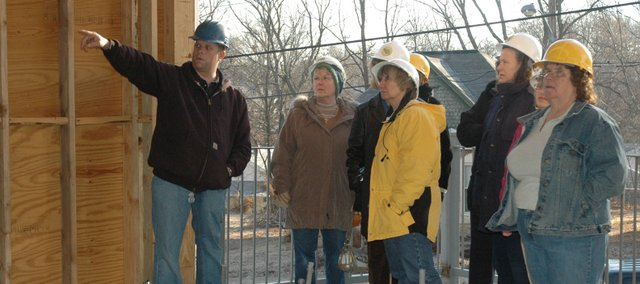Matt Beets, left, Bonner Springs Public Works project manager, gives a tour Thursday morning of the new Bonner Springs library to current library staff. The construction of the new library, which will be located on the corner of Nettleton and Insley, is expected to be completed in May.