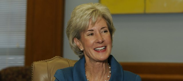 Gov. Kathleen Sebelius has signed a budget-reduction bill into law but applied her authority to line-item veto several items, including a cut to public schools that would have reduced spending by $66 per pupil.