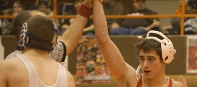 Matt Brock's hand is raised in victory following his win in the 140-pound regional championship bout at Abilene on Saturday.
