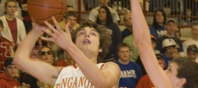 Dylan Scates goes up for a basket in the second quarter of Tonganoxie's 65-63 loss to Mill Valley on Tuesday.