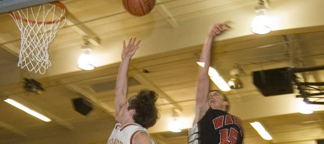 Jace Waters explodes to the basket during Tonganoxie High's 54-43 win over Bishop Ward on Friday.