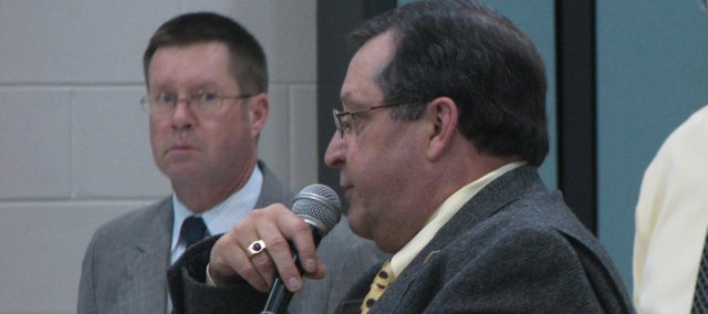 Leavenworth County Commissioner John Flower responds to a question at the Tuesday night public hearing concerning sewer district 3. The Kansas Department of Health and Environment ordered that the Glenwood lagoons be decommissioned by the end of the year.