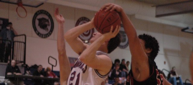 Zach Bryant has his shot blocked against Ottawa Tuesday at Eudora. The boys lost, 54-47.