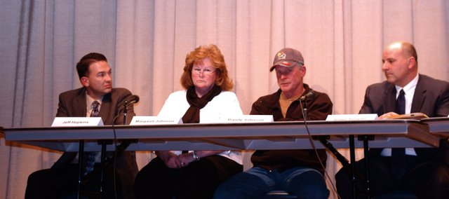 Jeff Hopkins, Margaret Johnson, Randy Johnson and Roger Templin, candidates for De Soto USD 232 Position 4, respond to questions last week at a forum at Lexington Trails Middle School.