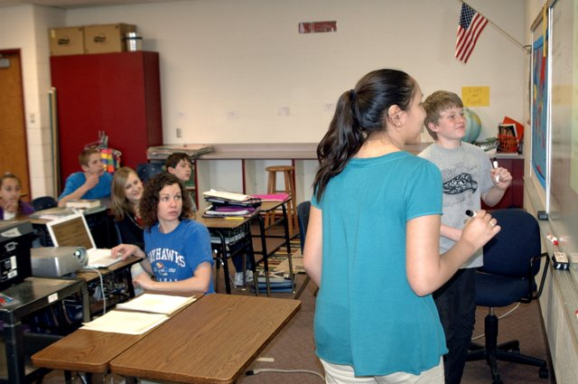 Miranda Joy, Eudora Middle School social studies instructor, helps her students Kiana Daboda and Sam Hanzlik prepare for a test. Joy was named the Eudora Chamber of Commerce's Teacher of the Month for February.