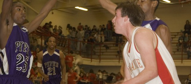Tonganoxie High senior forward Jamie Everett drives baseline on Friday night during the Chieftains&#39; 65-64 win over Piper. Everett scored 12 points for THS on Senior Night.