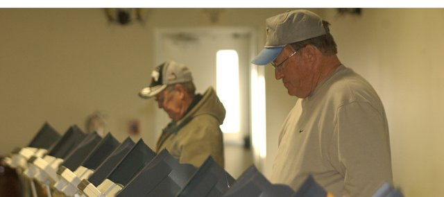Bill Trimble, foreground, and Shawn Griffiths vote in the primary election Tuesday morning at De Soto VFW Post 6654. Looks for the first results here shortly after 7 p.m. Tuesday and in Thursday's De Soto Explorer for full results.