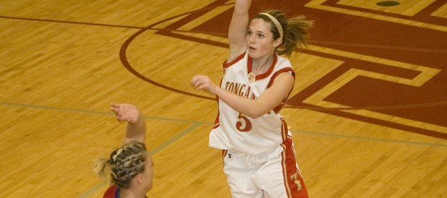 Andie Jeannin follows through on a three-point attempt in Tonganoxie's 61-27 sub-state victory over Hiawatha on Tuesday night at THS.