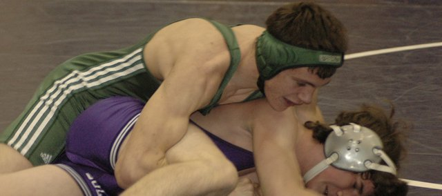 Daniel Goodin tangles with an opponent at the Frontier League Tournament. As one of many freshman on De Soto's squad, Goodin gained valuable varsity experience this year. The Wildcats showed improvement and went 5-7 in duals this year after going 1-11 last year.