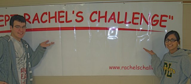 "Sophomore student council officer Owen Lewis (left) and student council president Amber Jeannin stand next to a banner that says ""I accept Rachel's Challenge.""  The students at Basehor-Linwood High School will have the opportunity to sign the banner after the Rachel's Challenge presentation on March 30."