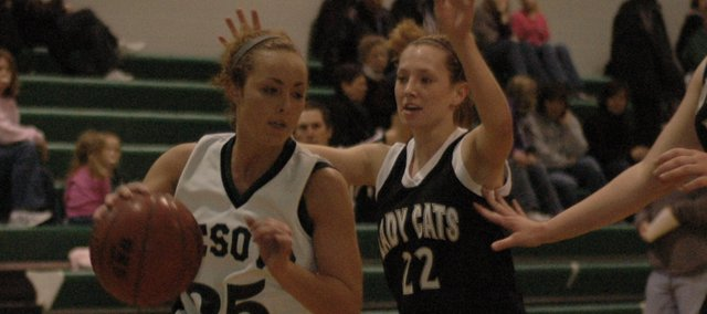 Kelsey Fisher drives to the paint against Louisburg earlier in the year. The De Soto girls finished with just three wins this season, but will lose only one senior. Fisher, a junior guard, was one of De Soto's top offensive players and could be better next season.