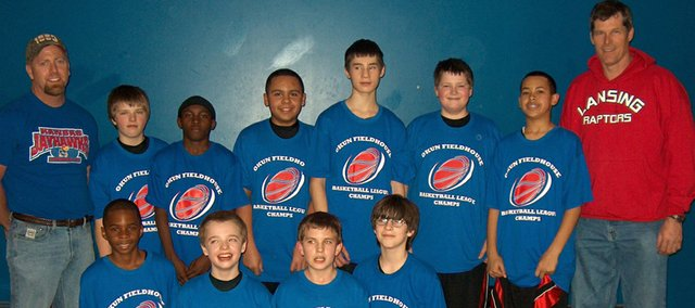Members of the Lansing Raptors are, front row: Markel Lewis, Nick Wagner, Eric Mitchell, Sam Nixon and (back row) Coach Jeff Wagner, Colin McQuillan, Carian Eaton, Cory Brantley, John Brackett, Trevor Young, Kenneth Banks and Coach Tom Young