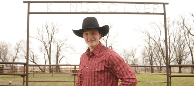 Skeeter Kingsolver, 19, of rural McLouth has made a career of riding bulls in the Professional Bull Riders rodeo circuit. The area in the background is where Skeeter practiced riding throughout high school.