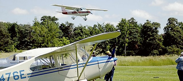 This plane was landing at the Vinland Airport during a Planes, Trains and Automobile event several years ago. The airport's runway is slated for $44,504 in improvements after the Kansas Department of Transportation funded three-fourths of the cost.