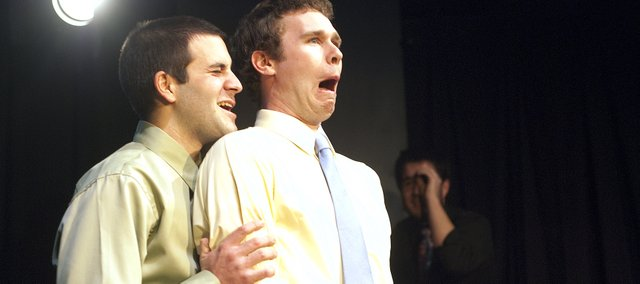 Doug Altman, left, and Garrett Kelly  act out a scene during Saturday night's Improv Thunderdome. Altman and Kelly are members of a Lawrence comedy group called Those People.